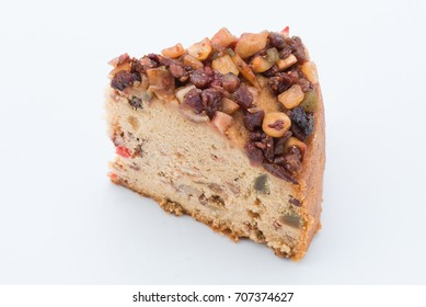 Piece of fruit cake is homemade on white background.