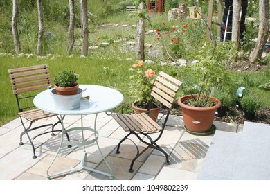 Piece of furniture in garden with flowers
