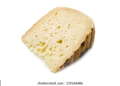 a piece of goat cheese isolated on white
