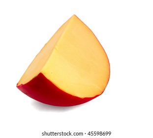 Piece of  gouda cheese isolated on white