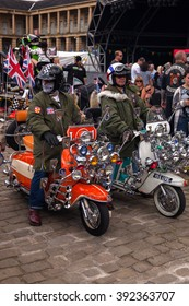 PIECE HALL, HALIFAX, YORKSHIRE, ENGLAND - AUGUST 25, 2012: Two men riding customised scooters. At Big D's Mods & Rockers Scooter & Bike Show organised by the Satans Slaves MC.