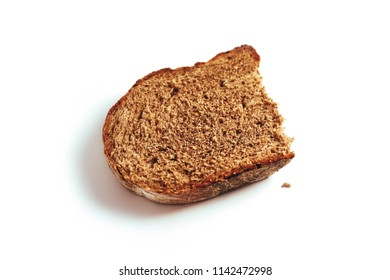 A piece of handmade freshly baked rye bread, isolated on white background.