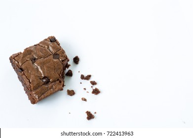 a piece of homemade delicious chocolate brownie, white background.