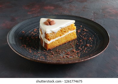 Piece of honey cake with almonds