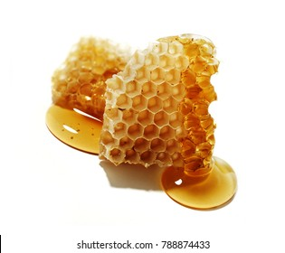 piece of honeycomb with honey,isolated on white