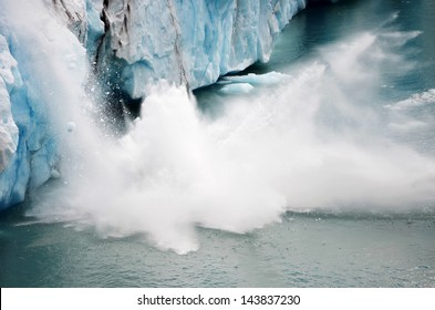 A piece of ice falling from the Perito Moreno glacier in Argentina with the splashes of water