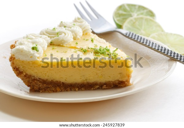 Piece of Key lime pie with lime zest and a fork