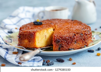 Piece of Kugel dessert of Jewish cuisine made of noodles, eggs and raisins on a close-up dish, selective focus.