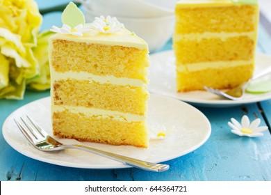 A piece of lemon sponge cake on a plate.