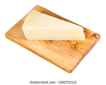 piece of local italian Pecorino Romano sheep's milk cheese on olive wood cutting board isolated on white background