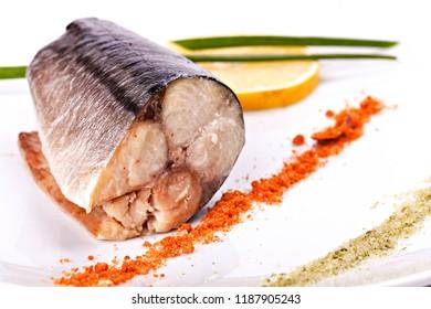 Piece of mackerel with lemon. Close-up.