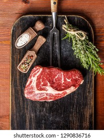 a piece of marbled beef. chef cooks steak