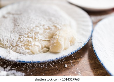 Piece of mochi sticky glutinous rice cake dusted with starch flour to make dessert