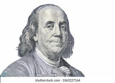 A piece of a money bill showing an important person is named  Benjamin Franklin isolated on white background. Symbol of 100 dollars.