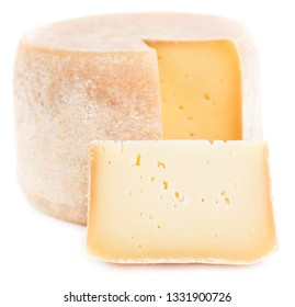 Piece of natural hard cheese isolated on white background.