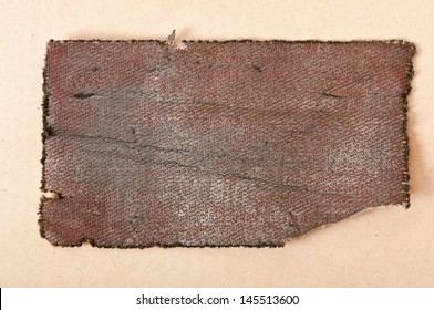 a piece of old cloth on a background of paper