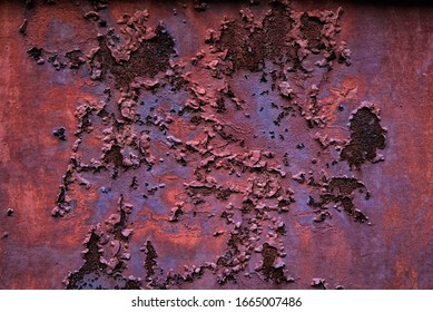 Piece of old metal covered with corrosion