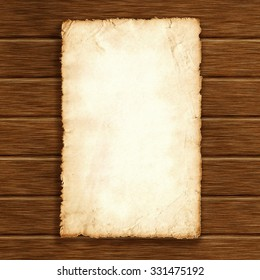 Piece of old paper on wooden background