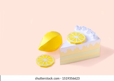 Piece of paper lemon cake. Cake is decorated with slice of lemon and cream. Volumetric handmade paper object. Paper art and craft. Trendy hobby. Minimal art food concept. Copy space