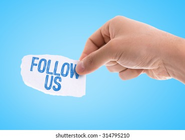 Piece of paper with the word Follow Us with blue background