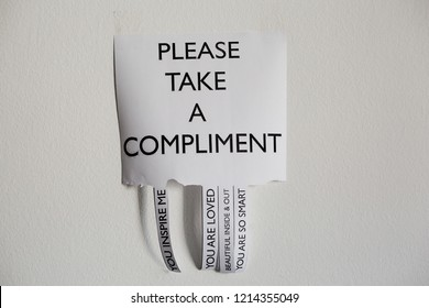 """Piece of paper writing """"Please take a compliment"""" and different inspiration and motivation messages, quotes. Wall sticker. Isolated. Hand writing. Letters, words, sentences,"""