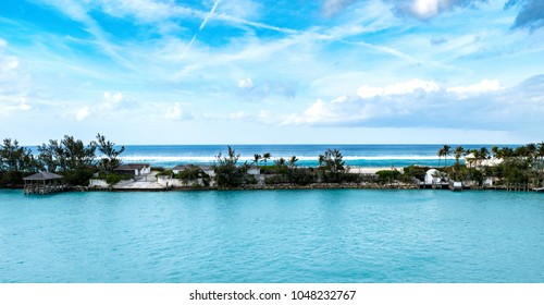 Piece of paradise. Tropical island paradise, with beautiful clouds seen in the distance against the calm waters