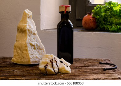 Piece of parmesan cheese with balsamic vinegar