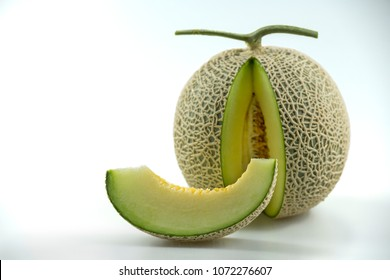 Piece and part of ripe japanese melons orange and green whole and slice on white table , cantaloupe or orange melon with seeds isolated on white background have clipping path