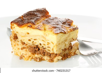 piece of pastitsio on dish, traditional greek food