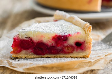A piece of a pie (cheesecake) with cherry filling
