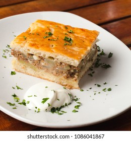 a piece of pie with mushrooms and potato