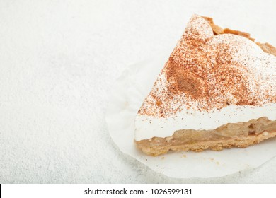 a piece of pie with sour cream on a white background.