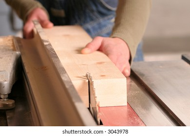 A piece of pine being ripped on an industrial tablesaw.