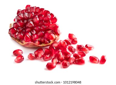 piece of pomegranate with heap of seeds isolated on white background
