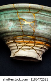 A piece of pottery that has been repaired with the kintsugi art form using lacquer and gold.
