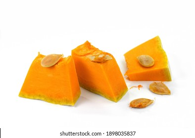 Piece of pumpkin isolated on white background. Pumpkin seed. Pumpkin pieces cut in a cube slice isolated on white background.