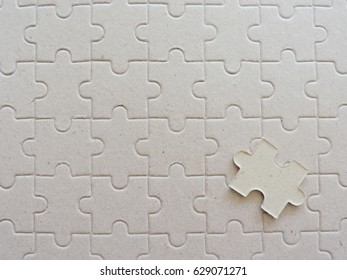 A piece of puzzle jigsaw on puzzle background.