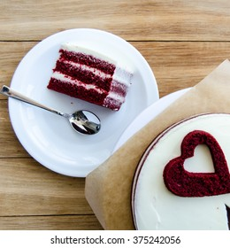 Piece of red velvet cake on a white plate