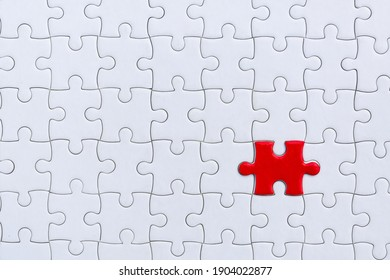 piece of Red and White jigsaw puzzle. teamwork concept.  symbol of association and connection. business strategy.