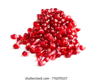 piece of ripe pomegranate with heap of seeds isolated on white background