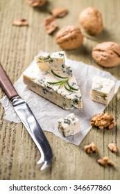 Piece of Roquefort cheese with walnut