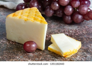 Piece of Saint Paulin creamy, mild, semi-soft French cheese made from pasteurized cow milk, originally made by Trappist monks