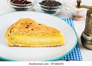 Piece of snack cake with cheese and cumin. Studio Photo