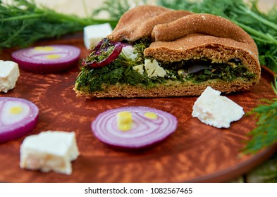 A piece of spinach pie with feta cheese onion on the clay brown plate. & Greek Cheese Pie Images Stock Photos \u0026 Vectors | Shutterstock