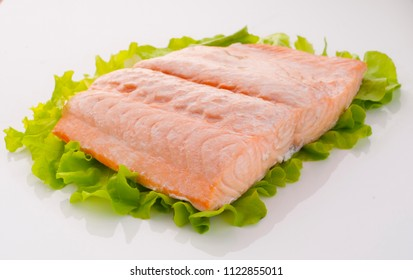piece of steamed salmon and lettuce
