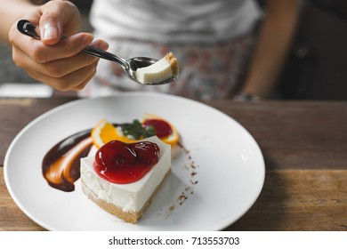 piece of strawberry cheese cake on white plate