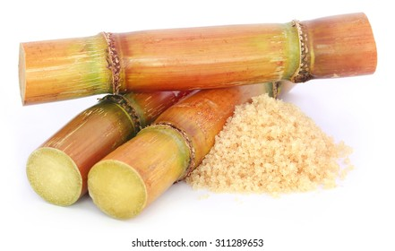 Piece of sugarcane with sugar over white background