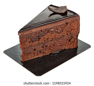Piece of sweet chocolate cake on a paper plate isolated on white. Delicious dessert.