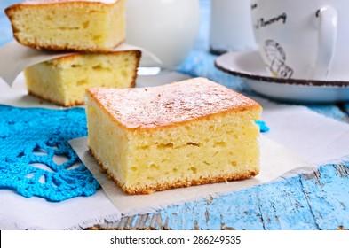 Piece of sweet sponge cake on paper in rustic style