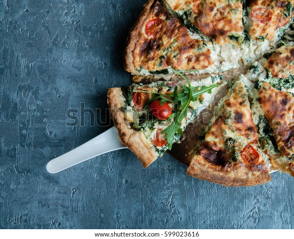 Piece of tart with tomatoes